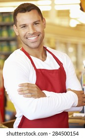 Male Cashier At Supermarket Checkout