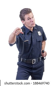 Male Caucasian police officer in blue cop uniform points finger accusingly at camera while placing other hand on black baton on white background