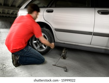 A male changing a tire quickly