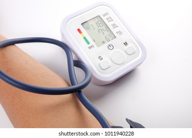 Male checking blood pressure on white background
