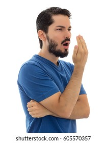 Male checking his breath with the hand. Bad breath. Halitosis concept.