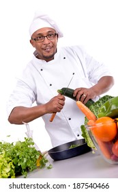 Male chef with fruits and vegetables cooking