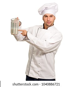 Male Chef Holding Jar Of Milk On White Background