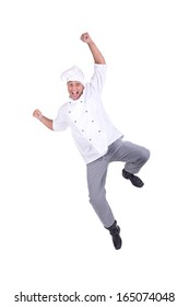 Male chef jumping isolated on white background