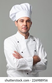Male chef posing with his arms crossed.