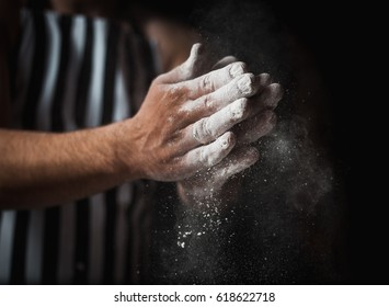 Male chef prepares a meal of flour