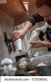 Male chef preparing ice cream in kitchen