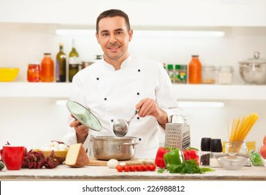 Male chef preparing italian food.