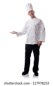 Male chef smiling pointing to a product isolated on white