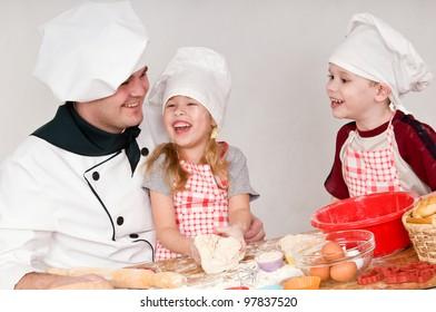 male chef tells the children something