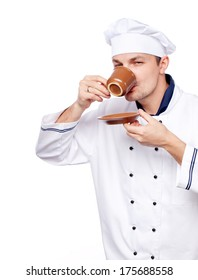male chef in white uniform and hat with red cup over white