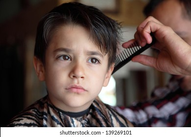 Male child at the barber shop to cut the hair