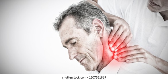 Male chiropractor massaging patients neck against highlighted pain