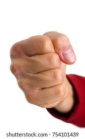 Male clenched fist isolated on white background closeup. Aggressive angry strong riot for freedom victory concept