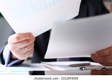 Male clerk arm examine important financial papers at workplace closeup. New angle look lobby bureaucracy form success opportunity advice law mediation participate corporate employee officer check