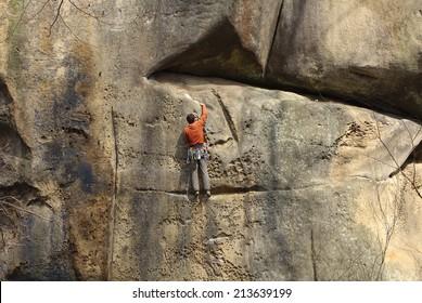 Male climber climbing rock face
