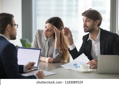 Male colleagues argue having dispute at company briefing, woman worker stay calm and peaceful managing stress distracted form conflict, managers or partners disagree on terms at meeting