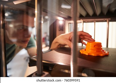 Male College Student Printing 3D Object In Design Lesson