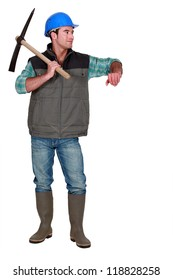A male construction worker with a pickaxe.