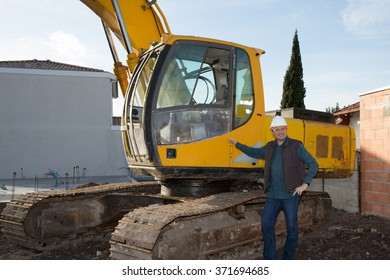 male construction worker repairing excavator track