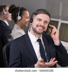 Male consultant explaining something to the customer using headset