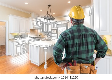 Male Contractor with Hard Hat and Tool Belt Looking At Custom Kitchen Drawing Photo Combination On White.