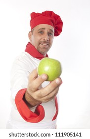 male cook in white uniform and hat with apples isolated on white background