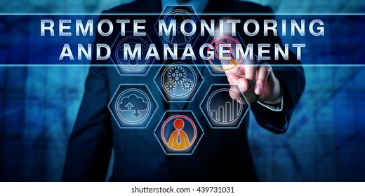 Male corporate business administrator in blue is pushing REMOTE MONITORING AND MANAGEMENT on an interactive control screen. Remote administration software concept. Industry term abbreviated as RMM.