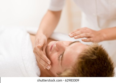 Male cosmetics - facial massage at luxury spa