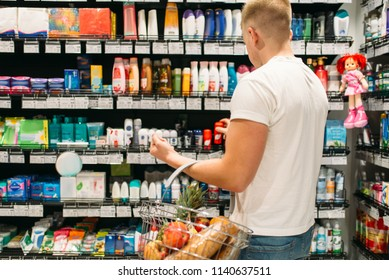 Male customer choosing personal hygiene products