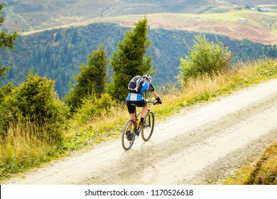 Male cyclist with healthy lifestyle mountain biking.