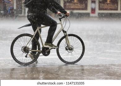 male cyclist in heavy rain