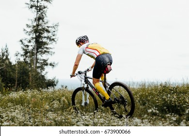 male cyclist mountain biking competition cross-country