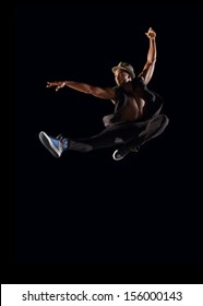 Male Dancer Leaping on Black Background