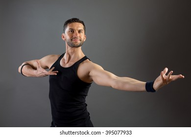 A male dancer performs in a studio