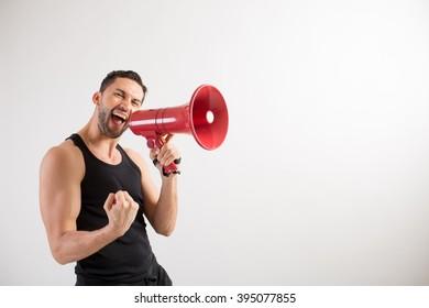 A male dancer shouts in a loudspeaker