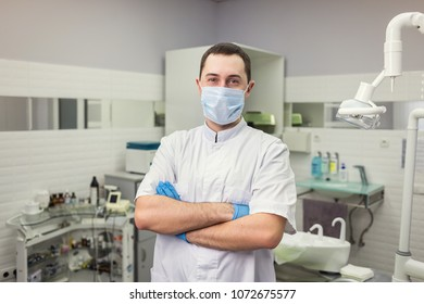 Male Dentist Standing Over Medical Office Stock Photo (Edit