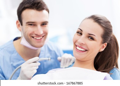 Male dentist and woman in dentist�s office