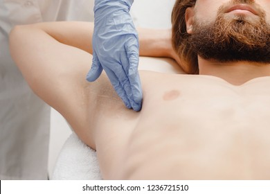 Male depilation laser hair removal underarms procedure treatment. Skin preparation process of preparing, applying gel