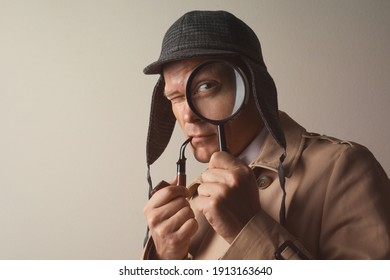 Male detective with smoking pipe looking through magnifying glass on beige background. Space for text