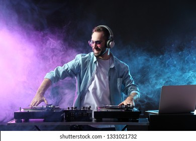 Male DJ playing music in club