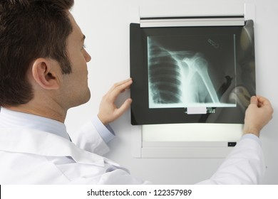 Male doctor analyzing x-ray image in hospital