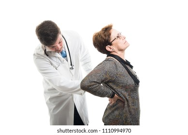 Male doctor checking female senior patient back isolated on white background