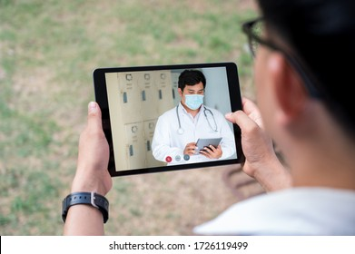 The male doctor counseled patients via video conferencing. Patients were at home to receive advice from the doctor.