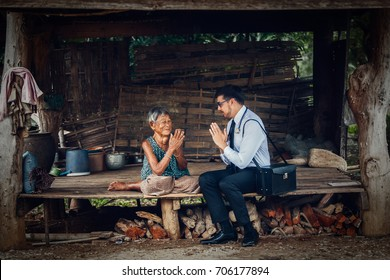Male doctor examining old woman's health, thailand