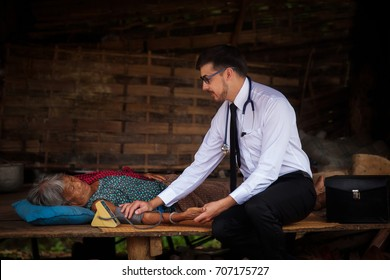 Male doctor examining old woman's health,woman asai ,thailand