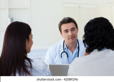 Male doctor explaining diagnosis to a couple during a visit