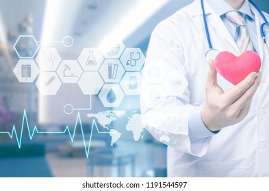 Male doctor with Heart in hand and icon medical network .Medical technology concept