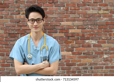 Male doctor with his arms crossed