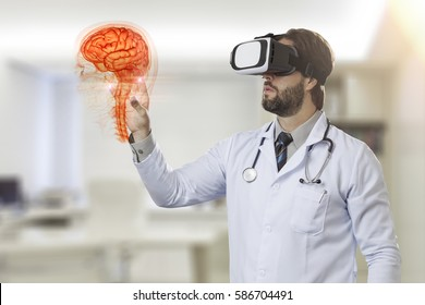 Male doctor in his office, using a Virtual Reality Glasses, looking at a virtual brain.